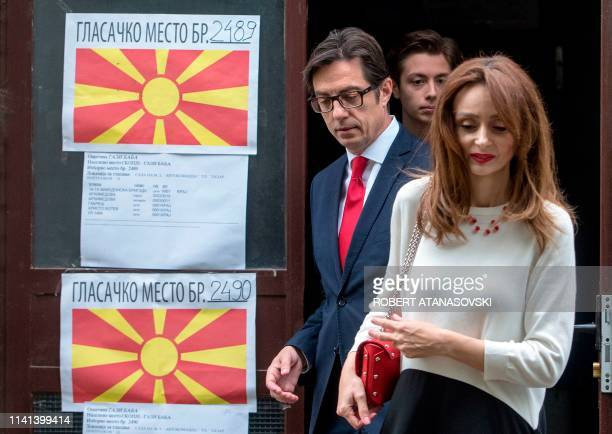 North Macedonia centreleft ruling SDSM Social Democrats party candidate Stevo Pendarovski leaves with his wife Elizabeta Georgievska and their son...