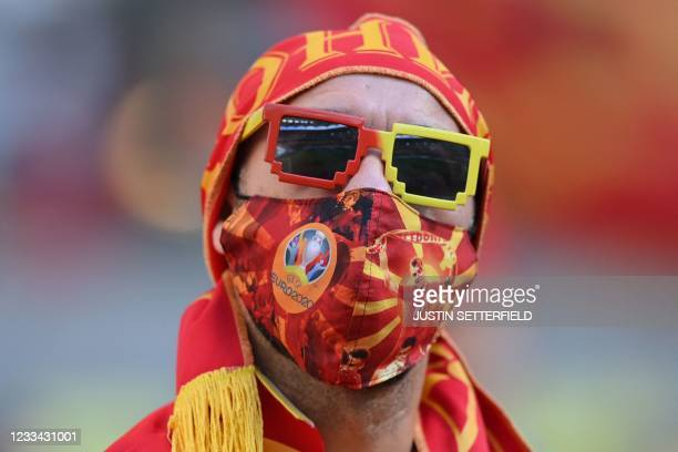 North Macedonia fan wears a mask as a precaution against the transmission of the novel coronavirus cheer before kick off of the UEFA EURO 2020 Group...