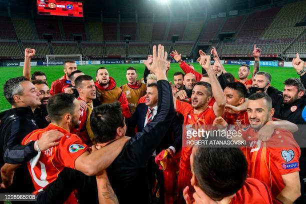 North Macedonia head coach Igor Angelovski celebrates his players at the end of the Euro 2020 playoff semi-final football match between North...
