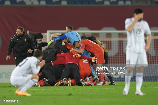 North Macedonia players celebrate at the final whistle during the UEFA EURO 2020 Play-Off Final between Georgia and North Macedonia at Dinamo Arena...