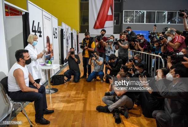 North Macedonia Prime Minister Zoran Zaev poses for journalists as he receives a dose of the Chinese Sinopharm Covid-19 vaccine as part of a mass...