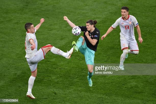 North Macedonia's defender Visar Musliu and Austria's midfielder Marcel Sabitzer vie for the ball during the UEFA EURO 2020 Group C football match...