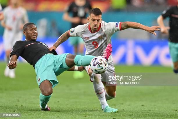 North Macedonia's forward Aleksandar Trajkovski and Austria's defender David Alaba vie for the ball during the UEFA EURO 2020 Group C football match...