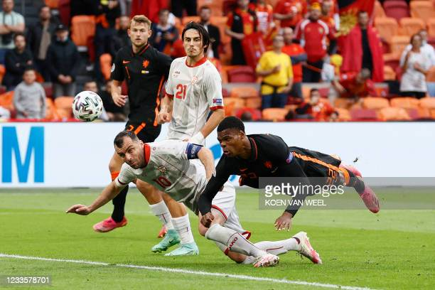 North Macedonia's forward Goran Pandev and Netherlands' defender Denzel Dumfries vie for the ball during the UEFA EURO 2020 Group C football match...