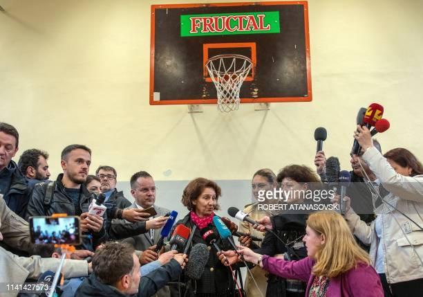 North Macedonia's opposition rightwing VMRODPMNE party candidate Gordana SiljanovskaDavkova addresses the press after casting her vote at a polling...