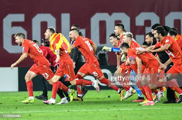 North Macedonia's players celebrate their victory at the end of the UEFA European qualifiers play-off final football match between Georgia and North...