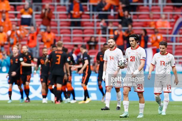 North Macedonia's players react to Netherlands' third goal scored by midfielder Georginio Wijnaldum during the UEFA EURO 2020 Group C football match...