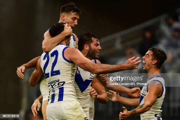 North Melbourne celebrates a goal by Todd Goldstein of the Kangaroos during the 2018 AFL round 10 match between the Fremantle Dockers and the North...