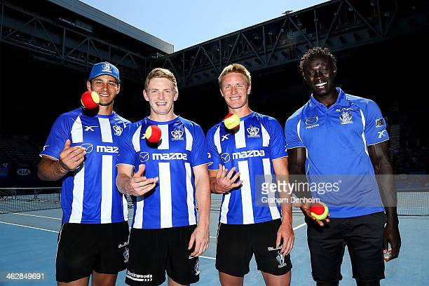 North Melbourne Kangaroos AFL players Robbie Tarrant, Jack Ziebell, Liam Anthony and Majak Daw pose prior to playing tennis with a group of kids in...