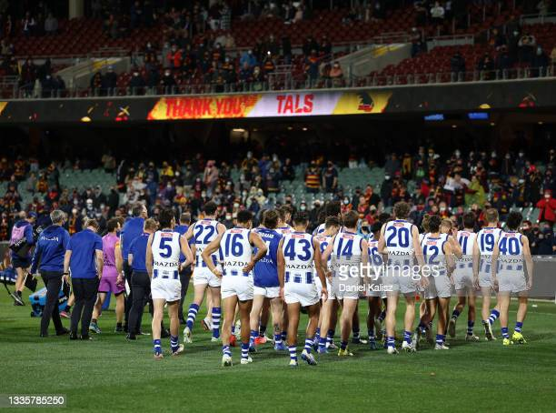 North Melbourne Kangaroos players walk from the ground during the round 23 AFL match between Adelaide Crows and North Melbourne Kangaroos at Adelaide...
