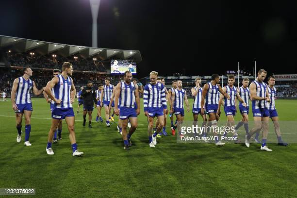North Melbourne players leave the field after a loss during the 2021 AFL Round 05 match between the Geelong Cats and the North Melbourne Kangaroos at...