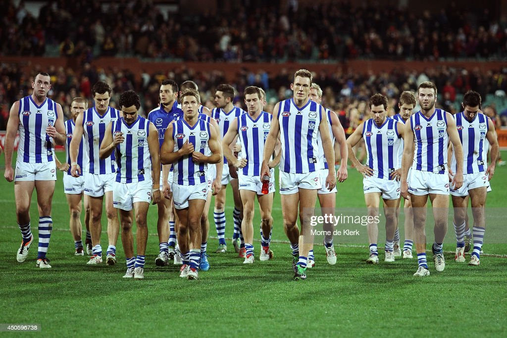 North Melbourne players leave the field after the round 13 AFL match between the Adelaide Crows and the North Melbourne Kangaroos at Adelaide Oval on June 14, 2014 in Adelaide, Australia.