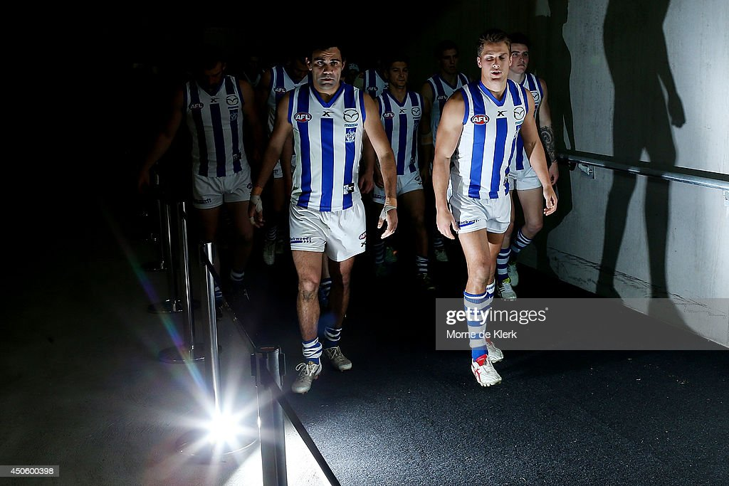 North Melbourne players take to the field after half time during the round 13 AFL match between the Adelaide Crows and the North Melbourne Kangaroos at Adelaide Oval on June 14, 2014 in Adelaide, Australia.