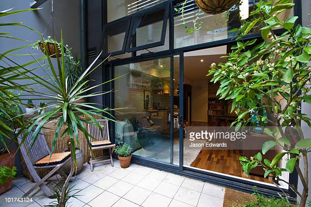 A small paved and gardened courtyard in an inner city townhouse.