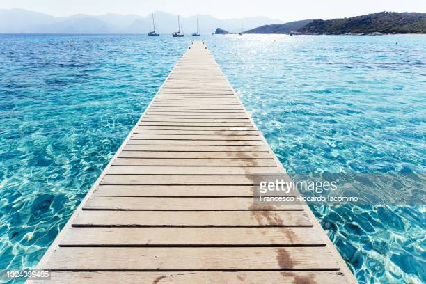 north of corsica island, lotus beach. turquoise sea bay with pier. france - francesco riccardo iacomino france foto e immagini stock
