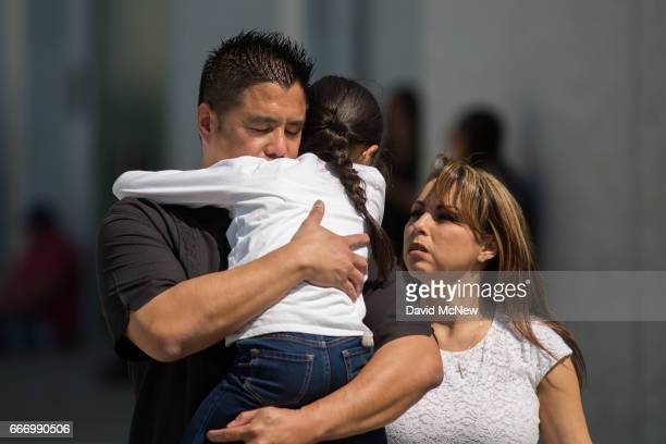 North Park Elementary School students and parents are reunited at Cajon High School after a shooting at their school on April 10 2017 in San...