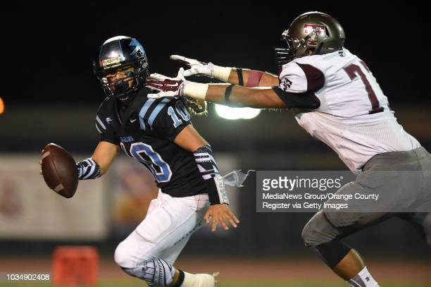 North QB Chris Kuaea is sacked by Torrance's Adrian Taylor for a 16yard loss in Torrance CA on Friday October 24 2014 Torrance football vs...