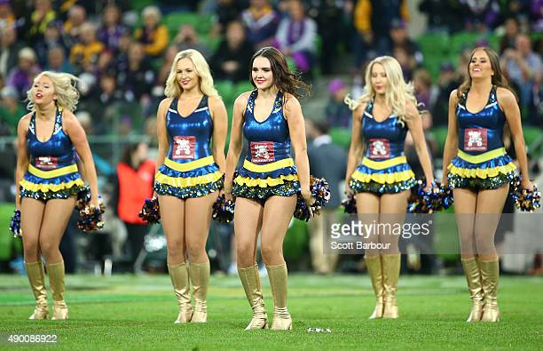 North Queensland Cowboys cheerleaders perform during the NRL Second Preliminary Final match between the Melbourne Storm and the North Queensland...