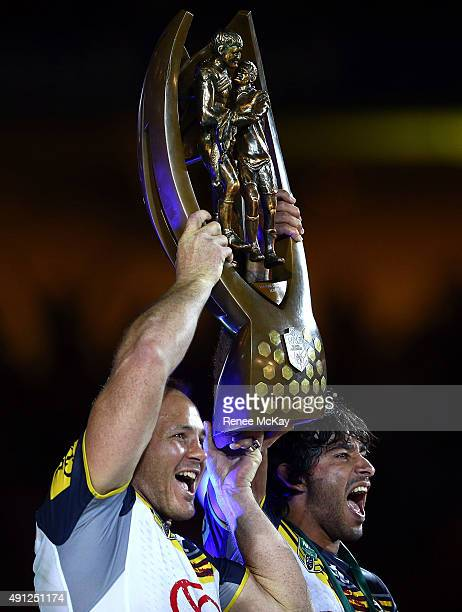North Queensland Cowboys co captains Matt Scott and Johnathan Thurston lift the NRL Premiership Trophy at the 2015 NRL Grand Final match between the...