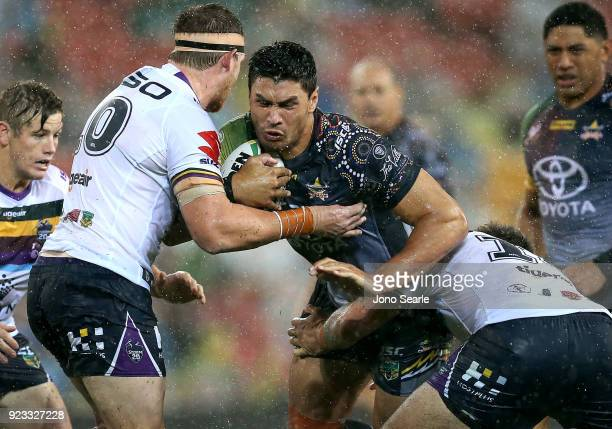 North Queensland player Jordan McLean takes a tackle during the NRL trial match and Jonathan Thurston/Cameron Smith Testimonial match between the...