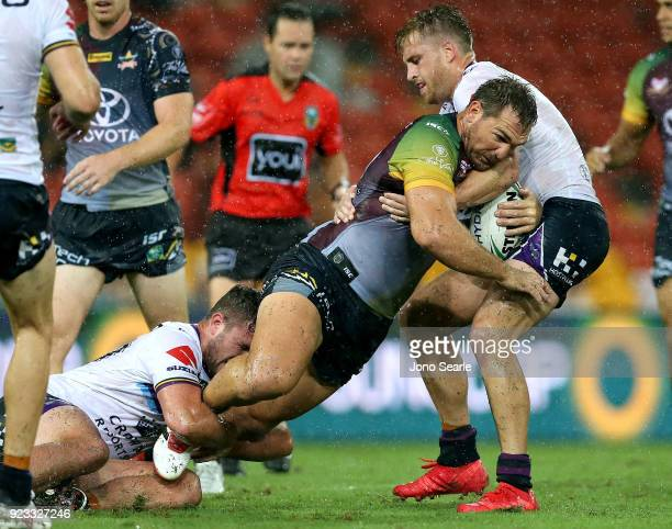 North Queensland player Scott Bolton takes a tackle during the NRL trial match and Jonathan Thurston/Cameron Smith Testimonial match between the...