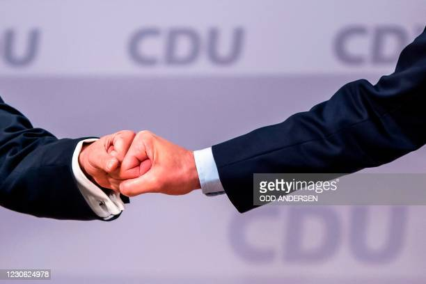 North Rhine-Westphalia's State Premier and new leader of the Christian Democratic Union Armin Laschet does a fist bump with candidate as leader of...