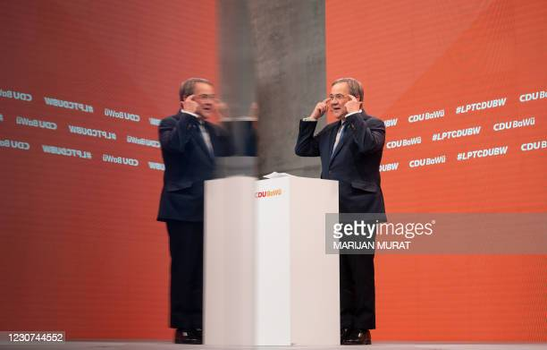 North Rhine-Westphalia's State Premier and new leader of the Christian Democratic Union Armin Laschet is reflected in a screen as he addresses the...