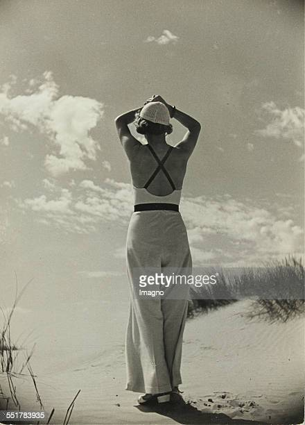 'North Sea resort Langeoog' Woman on the beach L1434 / 82 1935 231 167 cm Photograph by Dr Paul Wolff