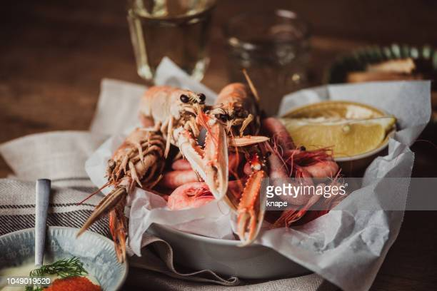 north sea shrimps and langoustine scampi served ready to eat - crayfish seafood stock pictures, royalty-free photos & images