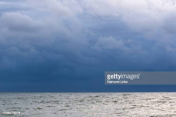 north sea with storm clouds, vorupor, nationalpark thy, thisted, north sea, north jutland, denmark - nationalpark stock pictures, royalty-free photos & images
