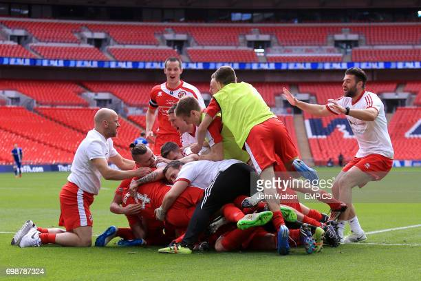North Shields' Adam Forster is mobbed by team-mates as he celebrates scoring their second goal of the game