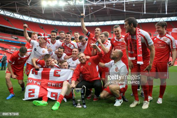 North Shields manager Graham Fenton celebrates victory with his team and the FA Vase trophy after the game