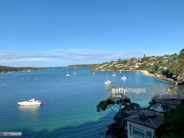 north shore ocean and harbour views in sydney, with boats dotted in the bays - seascape stock pictures, royalty-free photos & images