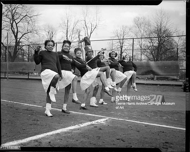 North Side Elks majorettes marching on Peabody High School football field at 20yard line Pittsburgh Pennsylvania November 1945