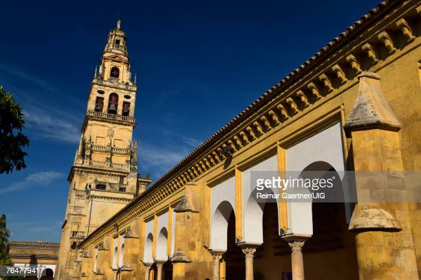 North side of the Cordoba Cathedral Mosque with bell tower topped by Archangel Raphael