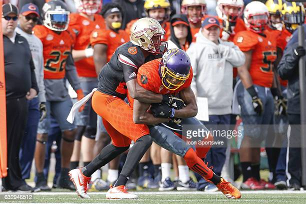 North Team Zay Jones is tackled by South Team Marquez White during the 2017 Senior Bowl college football game at LaddPeebles Stadium Mobile AL