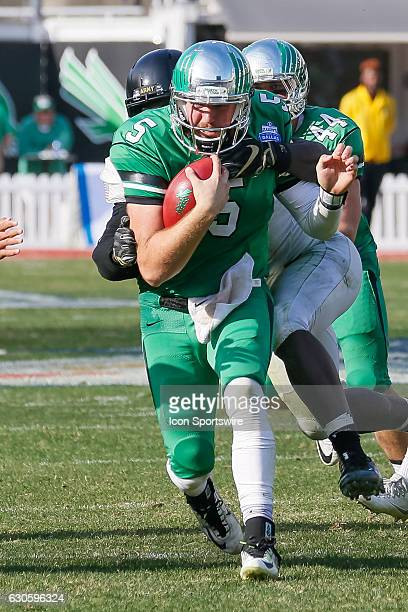 North Texas Mean Green quarterback Alec Morris runs with the ball during the Zaxby's Heart of Dallas Bowl between the Army West Point Black Knights...