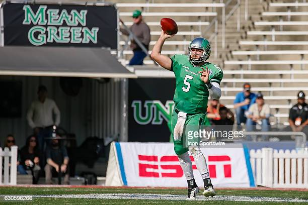 North Texas Mean Green quarterback Alec Morris throws a pass off his back foot during the Zaxby's Heart of Dallas Bowl between the Army West Point...