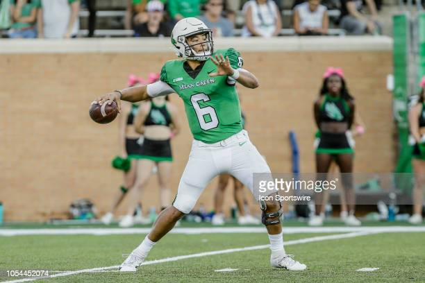 North Texas Mean Green quarterback Mason Fine looks downfield for an open receiver during the game between the North Texas Mean Green and the Rice...