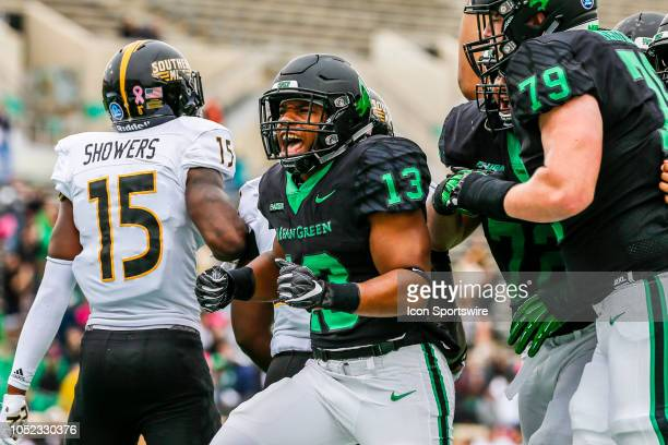 North Texas Mean Green running back DeAndre Torrey celebrates a touchdown with his teammates during the game between the North Texas Mean Green and...