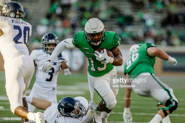 North Texas Mean Green running back DeAndre Torrey runs through the line of scrimmage during the game between the North Texas Mean Green and the Rice...