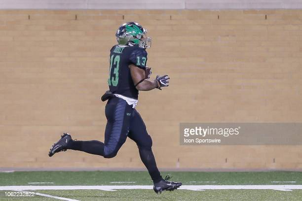 North Texas Mean Green running back DeAndre Torrey scores a touchdown during the game between the North Texas Mean Green and the Florida Atlantic...