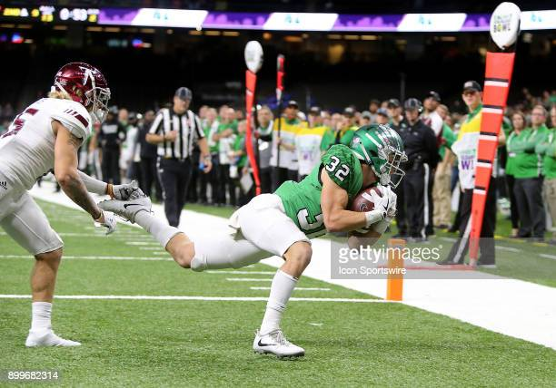 North Texas Mean Green wide receiver Michael Lawrence catches a pass for a touchdown during a football game between the Troy Trojans and the North...
