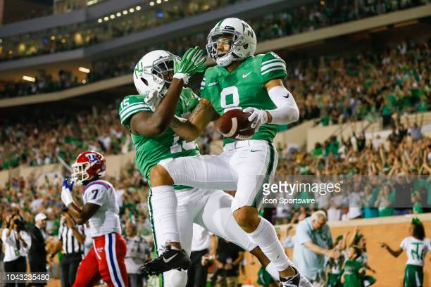 North Texas Mean Green wide receiver Rico Bussey Jr scores a touchdown and celebrates with tight end Caleb Chumley during the game between the North...