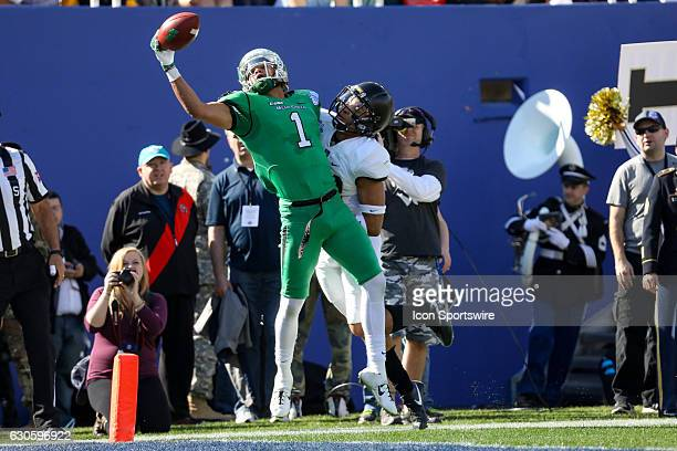 North Texas Mean Green wide receiver Turner Smiley attempts to catch a pass in the end zone during the Zaxby's Heart of Dallas Bowl game between the...