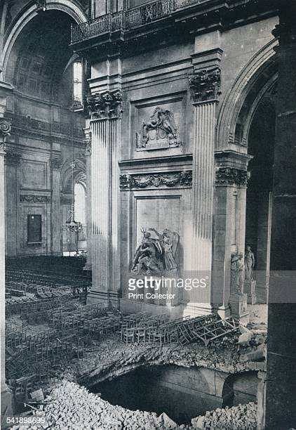 'North Transept of St Paul's Cathedral after a bomb had crashed through the roof into the crypt on the night of April 16th 1941' The cathedral was...