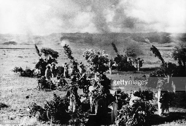A North Vietnamese antiaircraft artillery emplacement fighting off an American air attack December 1966