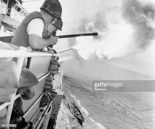 North Vietnamese fishing boat brushes past the cruiser U.S.S. Newport as she fires her eight-inch guns at Than Hoa.