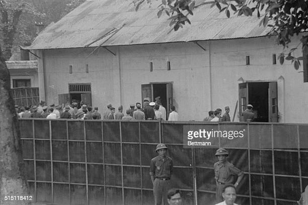 North Vietnamese guards talk with American POW's awaiting release at Ly Nam de Prison better known as the Hanoi Hilton