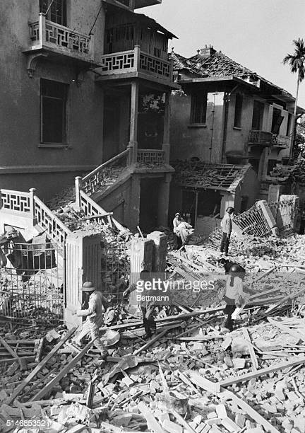 North Vietnamese rescue workers search the debris and rubble around the Cuban Embassy in Hanoi after a bombing by United States